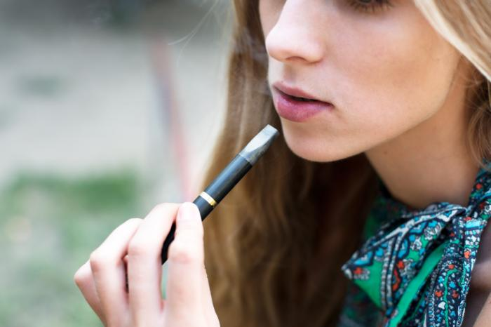 a girl using an e cigarette - E-CIGARETTES ARE NOT SAFE AS YOU THINK RESULTS ARE SHOCKING.