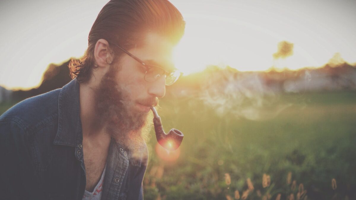 sunset summer hipster pipe - 12 Interesting Historic Facts About Beards