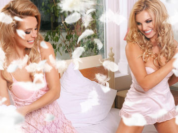 two-sexy-models-having-a-pillow-fight-on-a-bed (1)